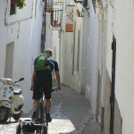 Cycling the streets of the old town, Tarifa, with trailer in tow for groceries