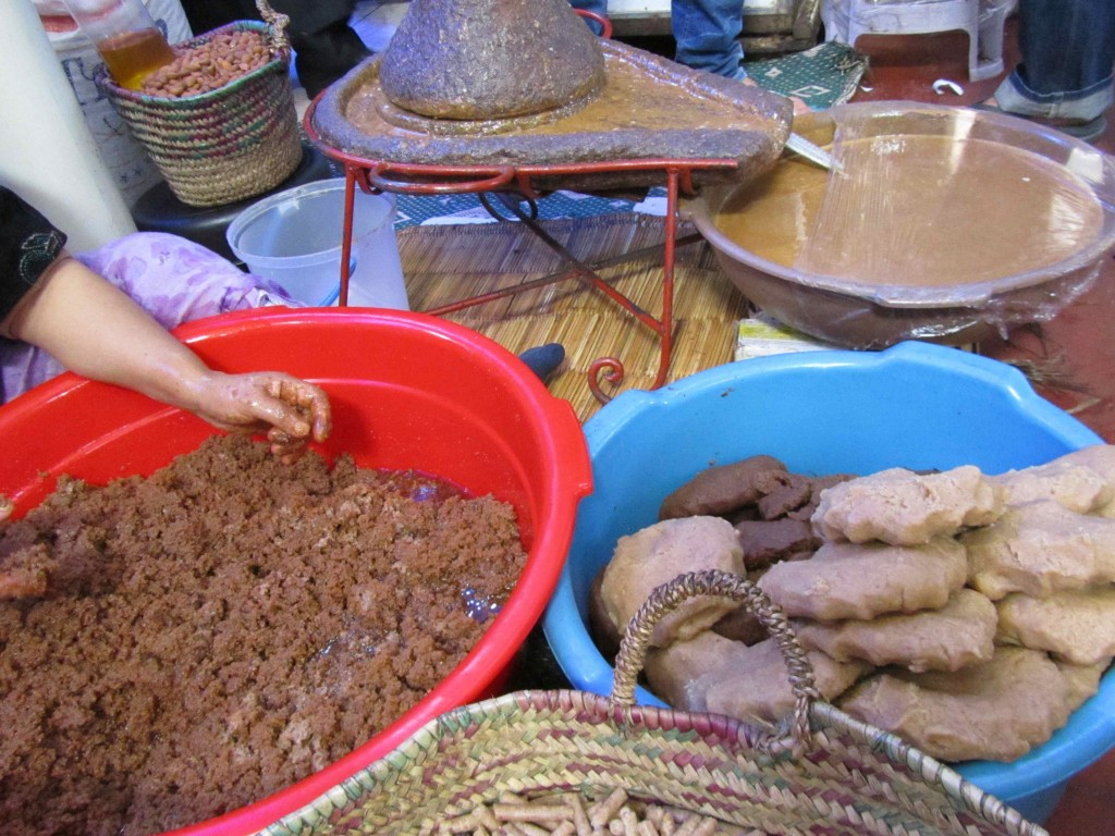 A woman pressing Argan kernels to extract the oil