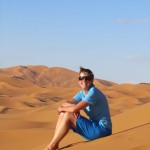 Taking a well needed rest while climbing the dunes