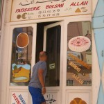 Leigh dashing in to a patisserie, Rissani, near Erg Chebbi