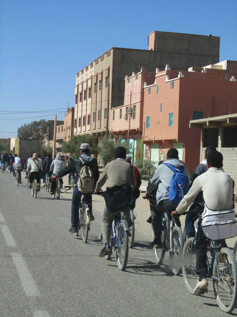 The school run at Tinejdad: reminded us of critical mass in London; all other traffic has to come to a standstill as the cyclists take over the entire road ...
