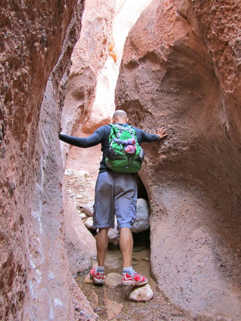 Leigh navigating through the narrow canyon