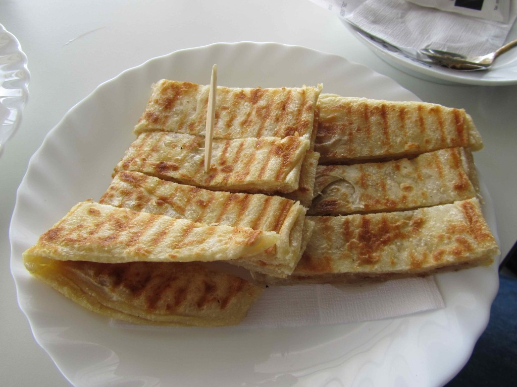 Msemmen, a fried dough breakfast pancake, with honey