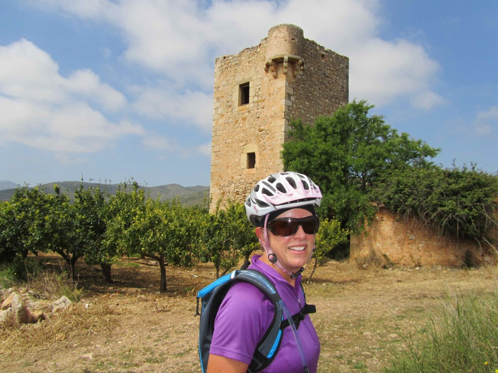 A torre nestled among the orange groves, cycling the Ruta de los Torres on the Orange Blossom Coast