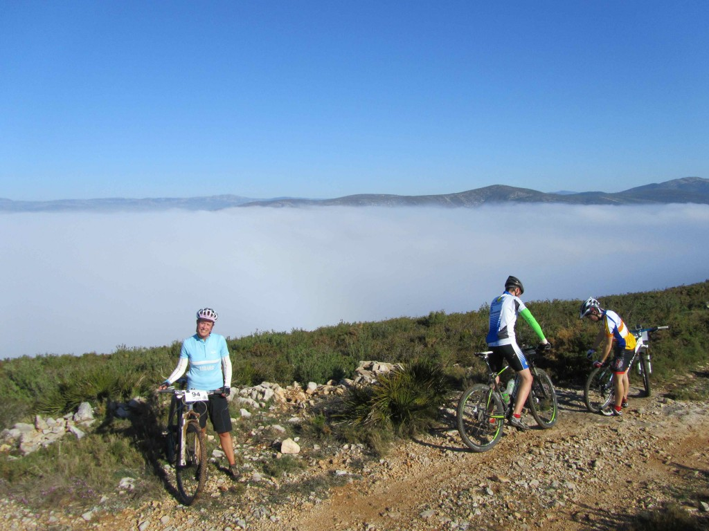 Cycling above the clouds, at the top of the 1st climb