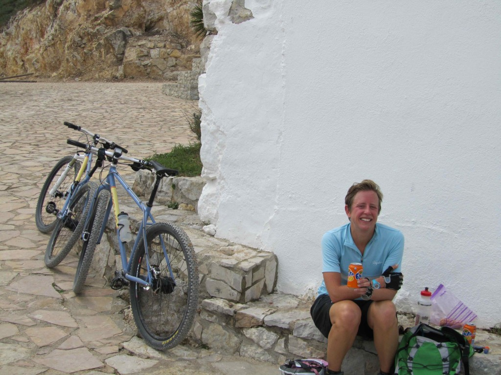 Half way through our a tough day on the bikes and the guys cleaning up at a mountain-top church gave us Fantas - just what we needed!