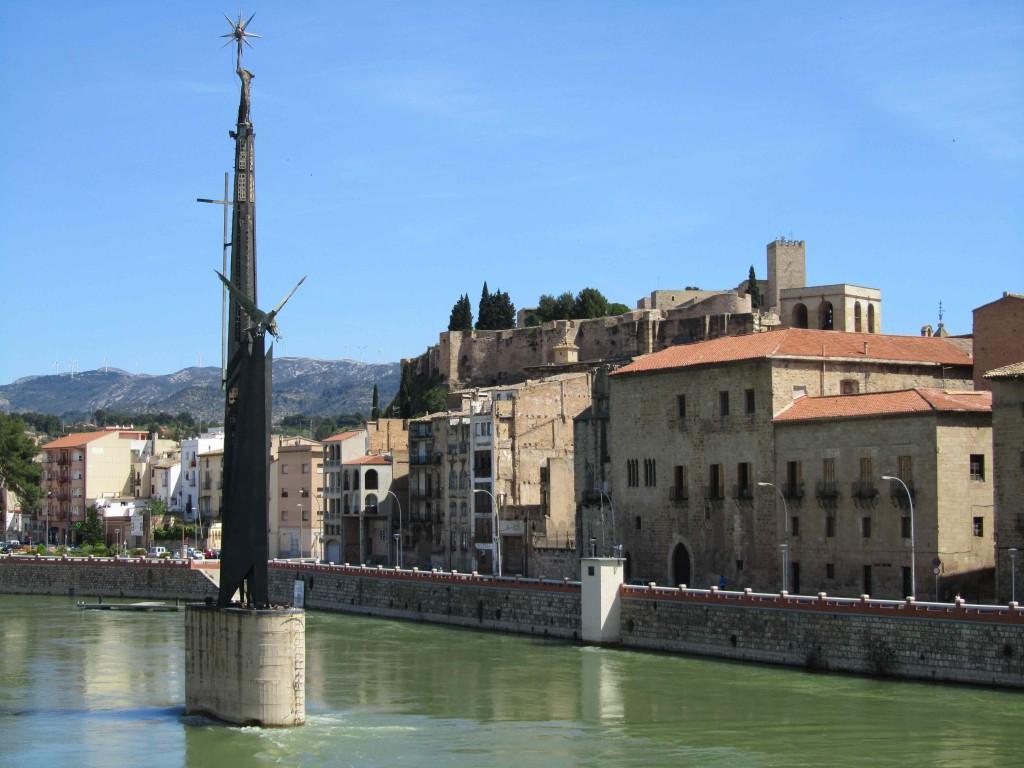 The green Ebra river flowing through Tortosa