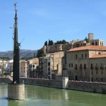 The green Ebra river flowing through Tortosa