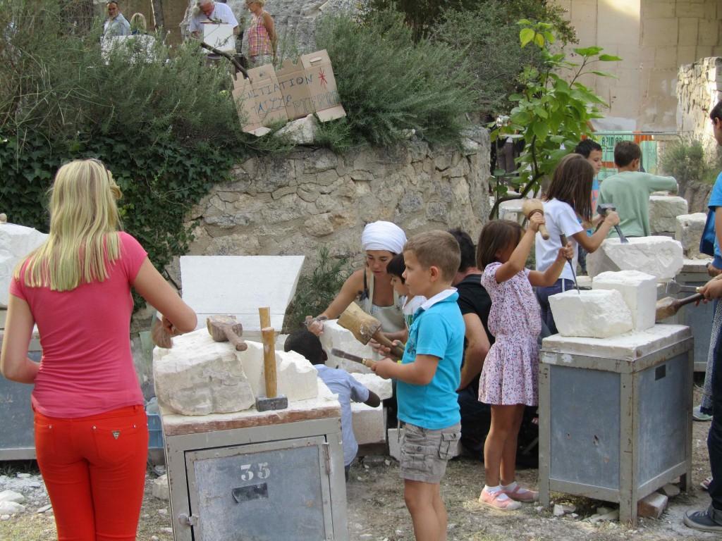 Young stonecarvers at work, Fete de la Pierre