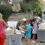 Young stonecarvers at work, Fete de la Pierre