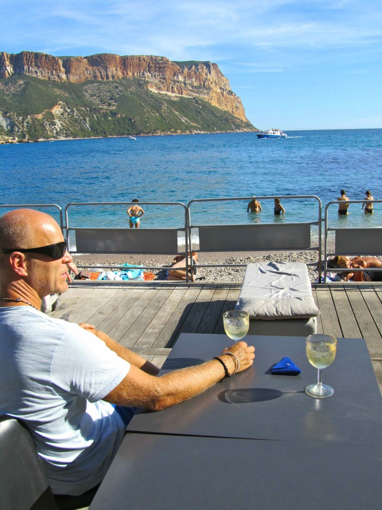 Enjoying the local wine after a long walk to explore the Calanques, at Plage de Bestouan